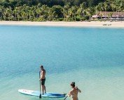 Six-Senses-Fiji-Paddleboarding-off-resort-shoreline